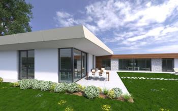 Pohľad zo záhrady. Denná časť domu je navrhnutá s veľkorysou výškou interiéru 3m.