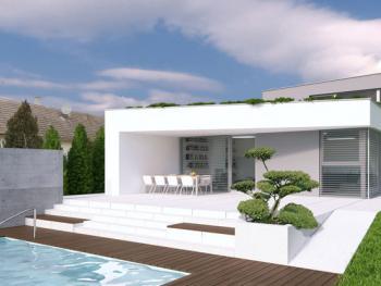 Pohľad zo záhrady. Veľkoryso riešená oddychová zóna poskytuje maximálny komfort obyvateľom domu.